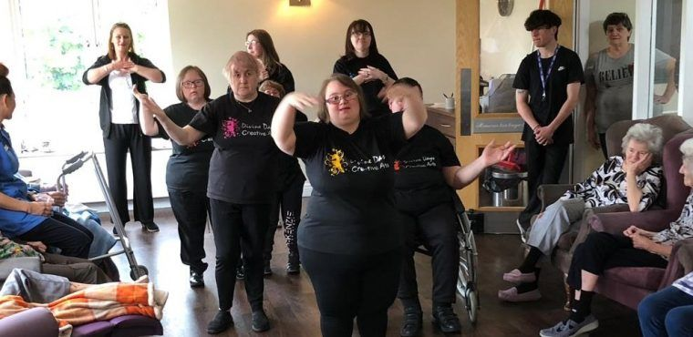 Singing and dancing gives residents a Divine Day