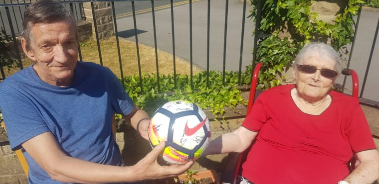 Huddersfield Town signed football auctioned for elderly