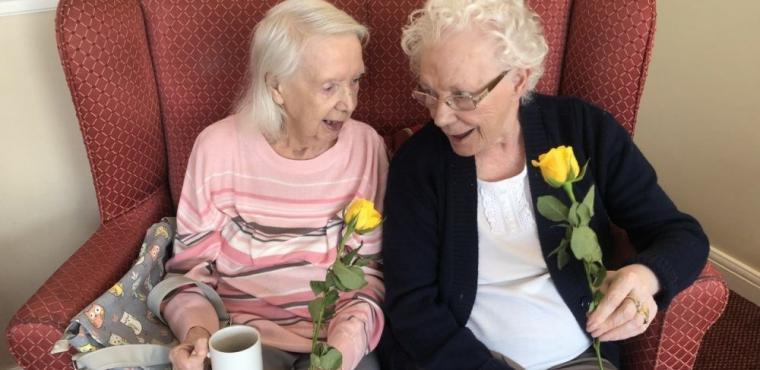 Roses and songs from primary pupils at care home