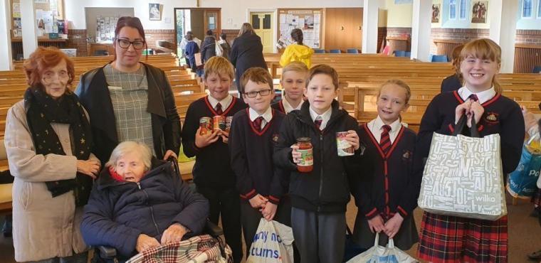 Children and pensioners celebrate harvest festival together