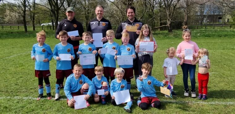 Young footballers kick-off pen pal friendship with elderly
