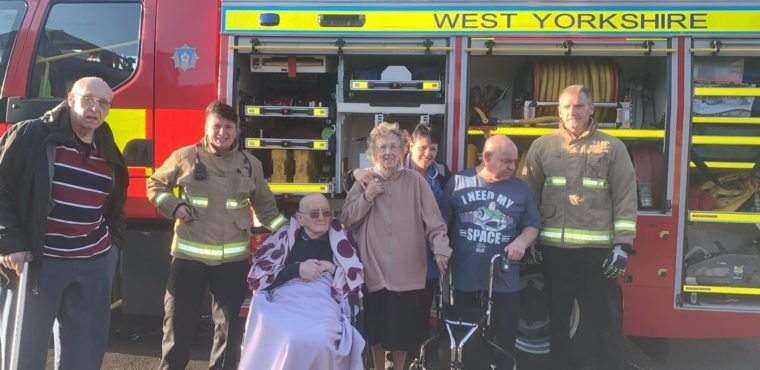 Fire service deliver early Christmas present for Clayton West care home resident