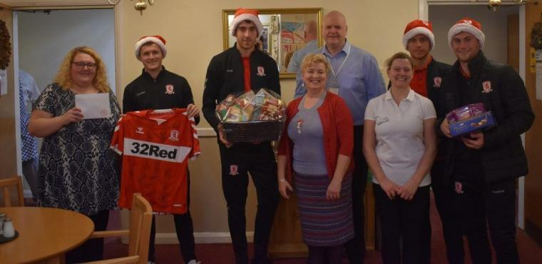 Boro's under 23s deliver Christmas gifts to elderly