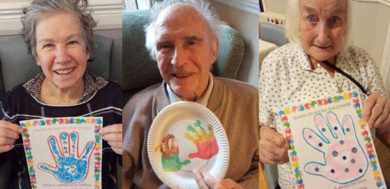 Handprint exchange between young and elderly to combat loneliness