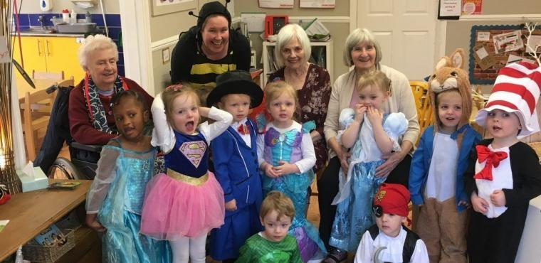 Youngsters greet elderly dressed as favourite book characters