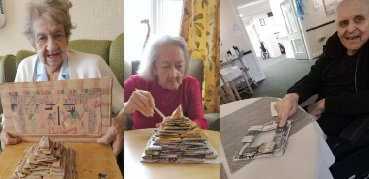 Residents build paper pyramid for archaeology competition