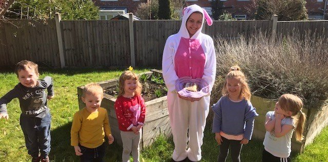 Toddlers team up with Easter bunny for care home egg hunt
