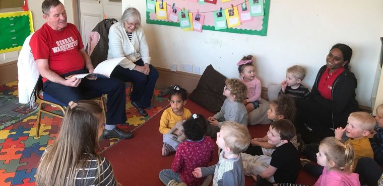 Elderly storytellers treat toddlers to tales and nursery rhymes