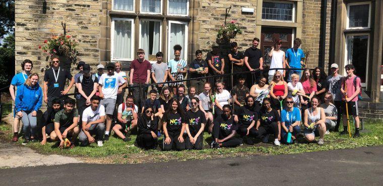 Dozens of teenagers landscape care home gardens