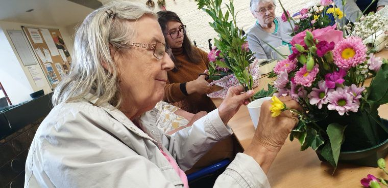 Elderly boost hand-to-eye coordination with flower arranging