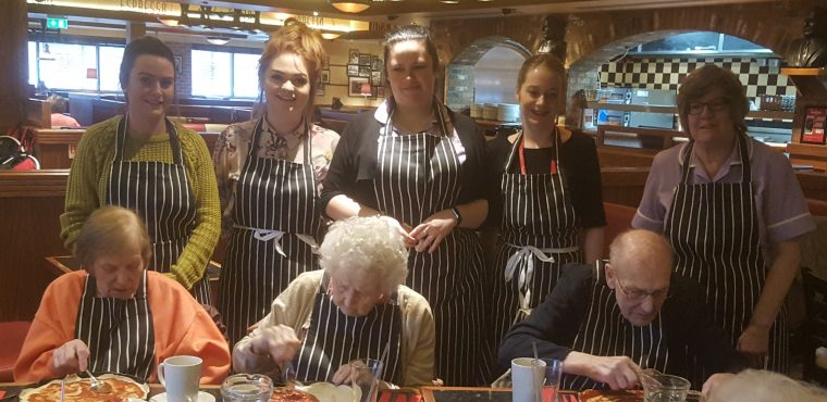 Aprons donned as elderly celebrate National Pizza Day