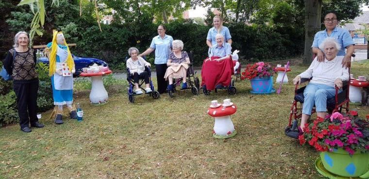 Alice scarecrow in Wonderland wins care home competition