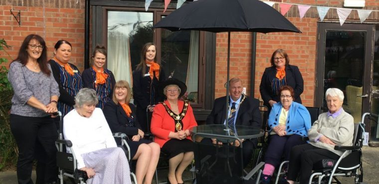 Travel agency's garden furniture donation to care home