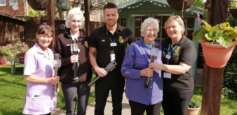 Ambulance staff donate plants for care home sensory garden