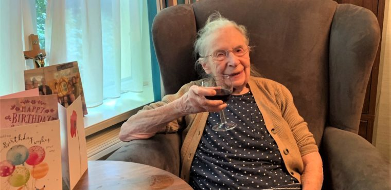 Winifred raises a glass of red to her 102nd birthday