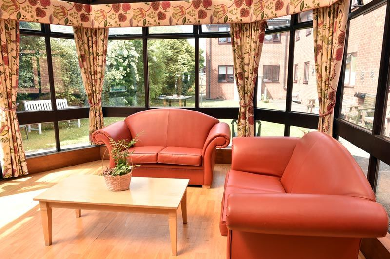 brown sofas in conservatory