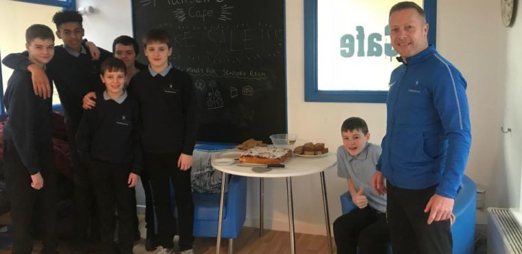 Pupils' charity bake sale at care home coffee event