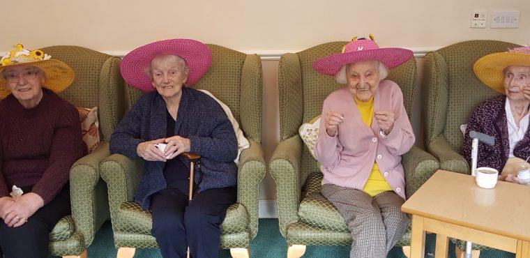 Pupils judge care home bonnet decorating competition