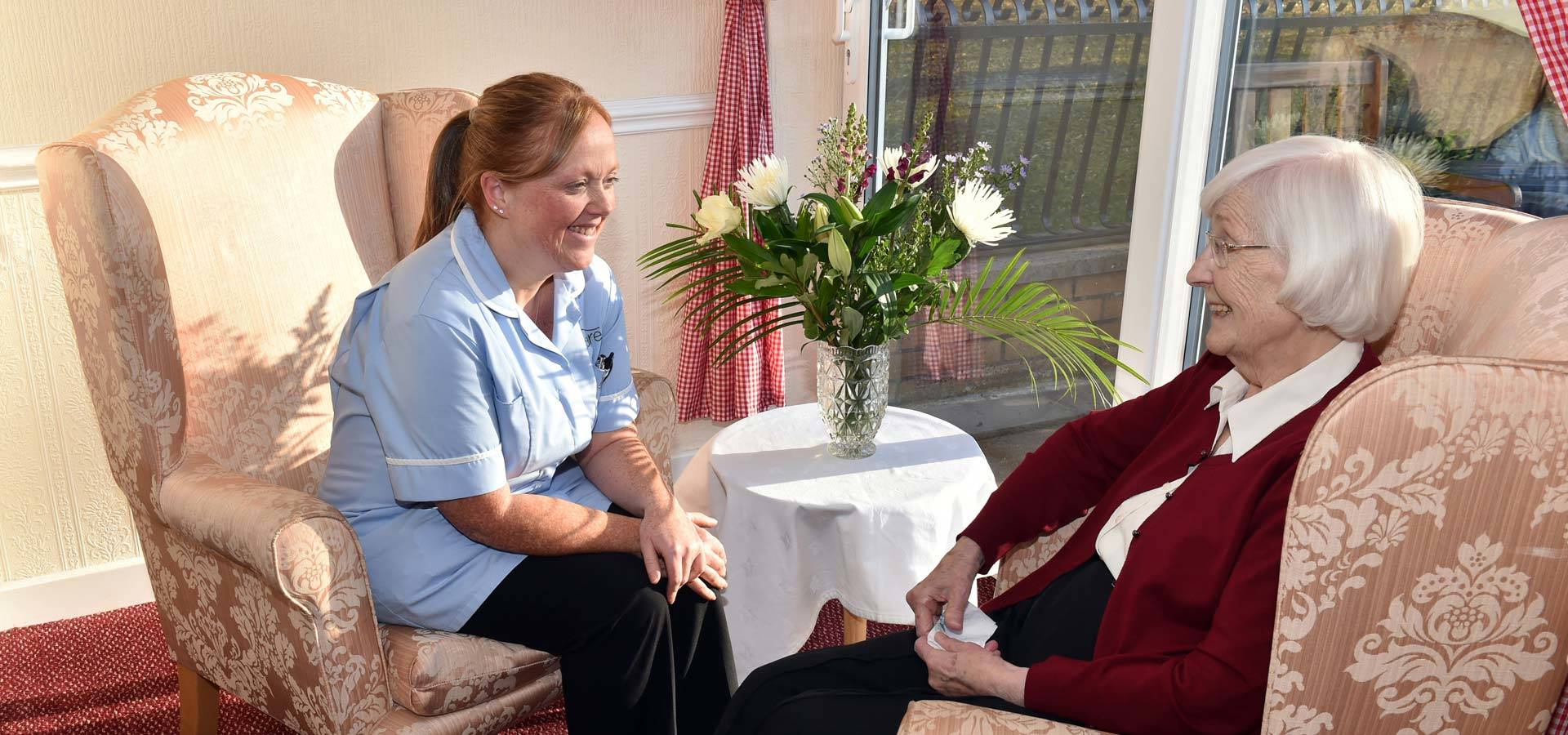 care home work and residents having chat