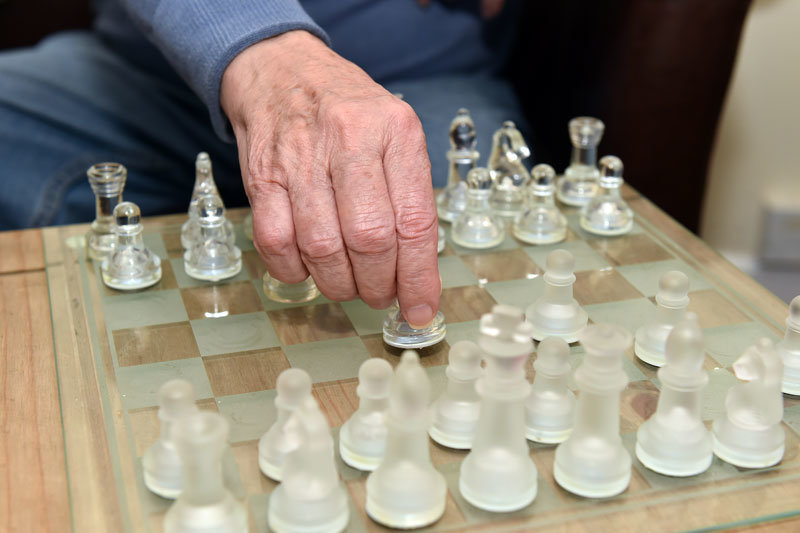 home resident playing chess