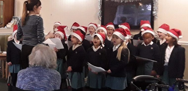 School choir performs Christmas carols for elderly