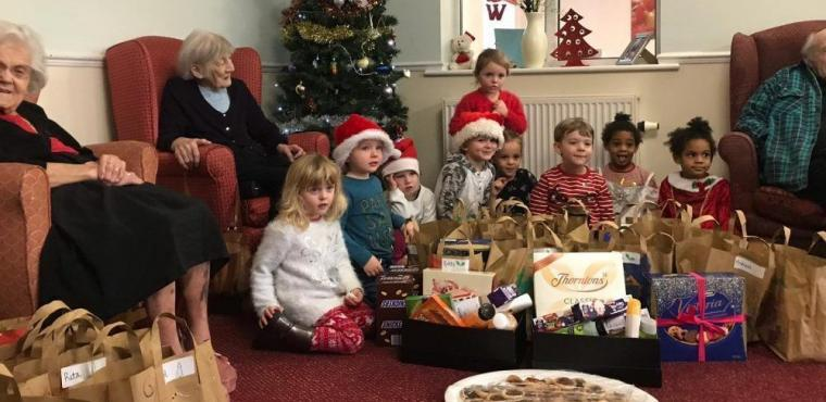 Youngsters deliver dozens of Christmas presents to elderly