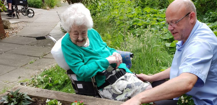 100-year-old Mabel plants a flower in memory of her father