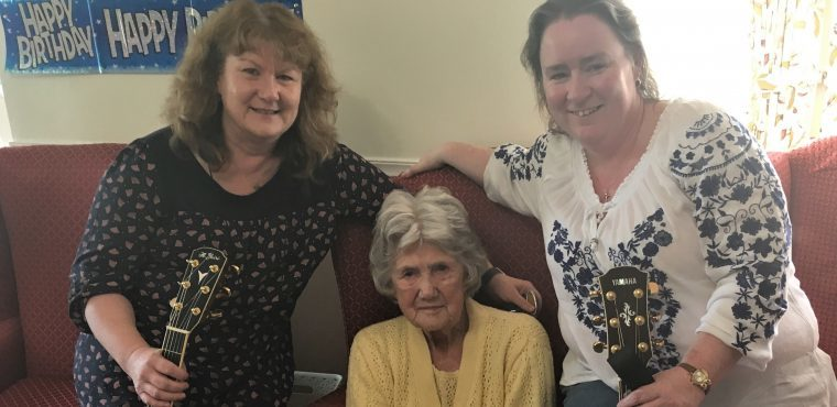 Elderly residents enjoy a singalong for Care Home Open Day