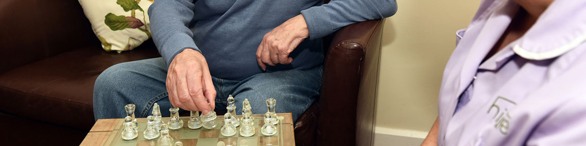 a resident playing chess
