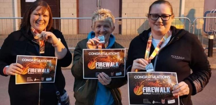 Care home staff take on fire walk for residents