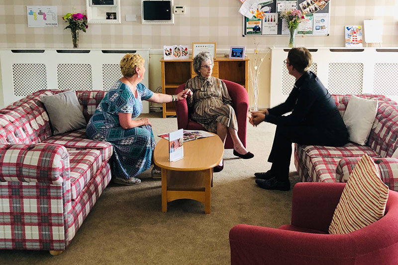 staff having chat with residents care home County Durham