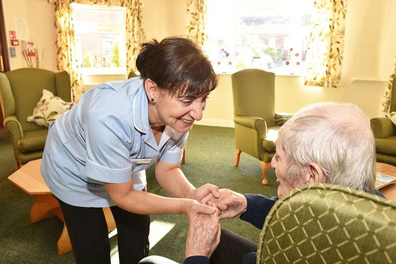 staff helping resident care home