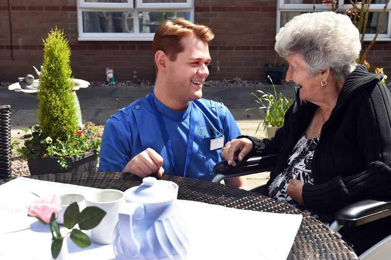 a worker talking to a care home resident